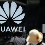 Battered by US sanctions, Huawei plans switch to electronic vehicles